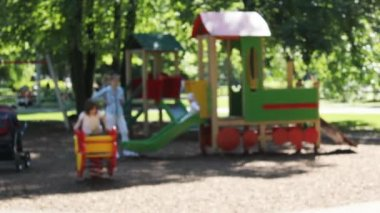 Playground in the city park. Out of focus — Stock Video
