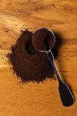 Metalic spoon and coffee — Stock Photo