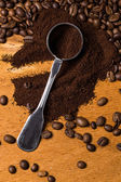 Metalic spoon and coffee — Stock Photo