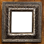 Vintage photo frame over wooden background — Stock Photo