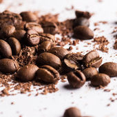 Coffee beans and particles of black chocolate — Stock Photo
