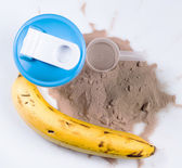 Shaker, protein powder and banana — Stock Photo