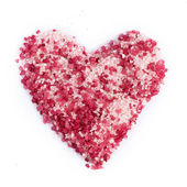 Sea salt for spa in heart shape — Stock Photo