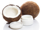 Coconut and moisturizer cream — Stock Photo