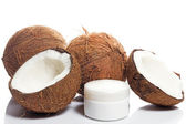 Coconut and moisturizer cream — Stock Photo