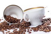 Coffee beans and cups — Stock Photo