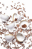 Falling coffee cups and beans — Stock Photo