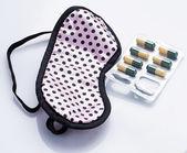 Mask and sleeping pills — Stock Photo
