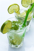 Fresh drink with lime and mint — Stock Photo