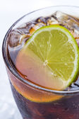Fresh cocktail with cola drink and lime — Stock Photo
