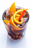 Cold cocktail with orange fruit — Stockfoto