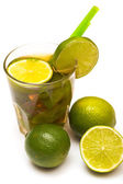 Glass of fresh ice tea with lime — Stock Photo