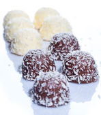 Chocolate candies with coconut flakes — Stock Photo