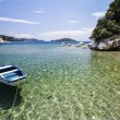 Moored boat near the beautiful cove, clear water. — Stock Photo