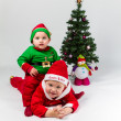 SantClaus and Santa's Helper baby boys — Stock Photo #40434073