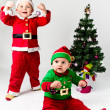 Stock Photo: Santa Claus and Santa's Helper baby boys