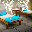 Royalty-Free Stock Photo: Blue spa-resort loungers in beautiful exotic resort