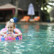Cute little girl with rubber ring in swimming pool - Foto de Stock