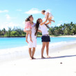 Royalty-Free Stock Photo: Young beautiful family with two kids on tropical vacation