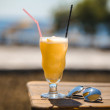 Royalty-Free Stock Photo: Bocal of fruity cocktail on a beach table