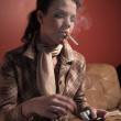Woman smoking cigarette — Stock Photo