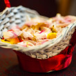 Flower petals in a basket — Stock Photo