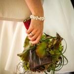 Bride holds wedding bouquet — Stock Photo
