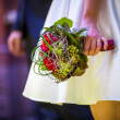 Bride holds wedding bouquet — Stock Photo