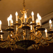 Big luminous chandelier — Stock Photo