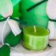 Small green candle - Stock Photo