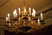 Big luminous chandelier — Stock Photo