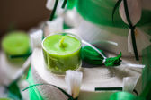 Small green candle — Stock Photo