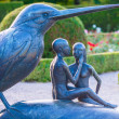 Bronze statue of a bird and couple — Stock Photo