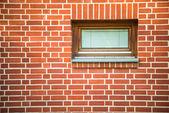 Redbrick wall with window — Stock Photo