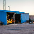 Blue shed at dockyard — Stock Photo #29007775