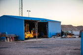 Blue shed at dockyard — Stock Photo