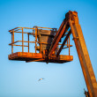 Orange hoisting crane — Stock Photo