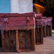 Heavy wooden trunks — Stock Photo