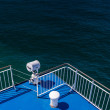 Flood light and railing of a ferry — Stock Photo