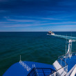 Stock Photo: Two blue ferries crossing North Sea
