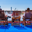 Man and woman sit in deck chairs — Stock Photo