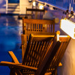 Wooden deck chairs on a ferry — Stock Photo