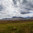 Stock Photo: Cloudy sky over an Icelandic fjord