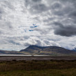 Stock Photo: Cloudy sky over Icelandic fjord