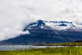 Mountain shrouded in clouds on Iceland — Stock Photo