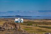 Blue house near Djupivogur, Iceland — Stock Photo
