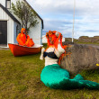 Fisherman and mermaid in Djupivogur on Iceland — Stock Photo