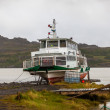 Stock Photo: Old boat at lake on Iceland