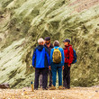 Four people stand and talk in Iceland — Foto Stock