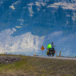 Two people cycling through Iceland — Stock Photo